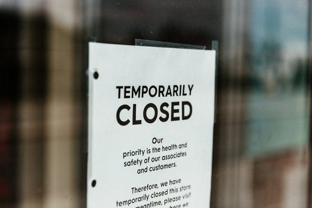 temporarily-closed-sign-on-door.jpg