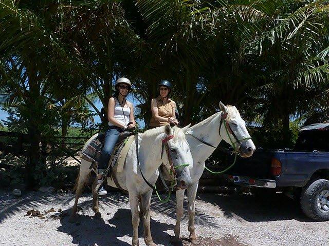Caren and daughter horseback